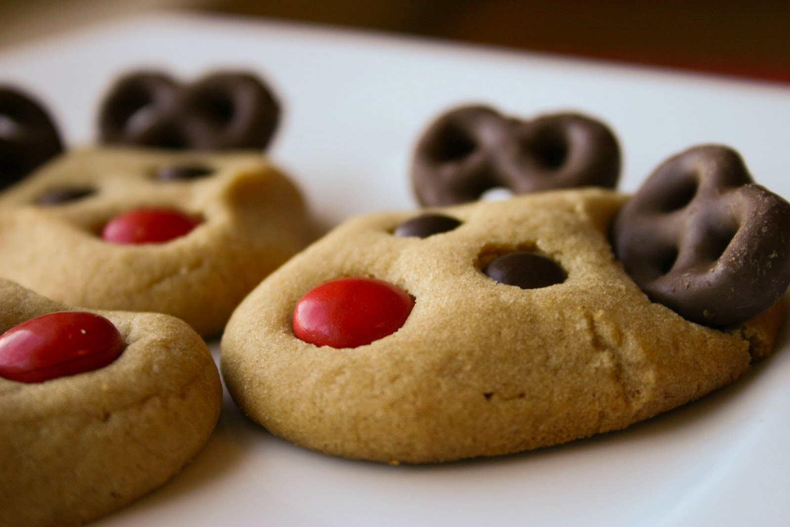 This year, I've taken my sugar cookie decorating up a festive notch with my reindeer sugar cookies! With red M&Ms for noses, chocolate-frosting balls for eyes and pretzel sticks for antlers, these Rudolph-inspired sugar cookies are almost too cute to eat. Almost.
