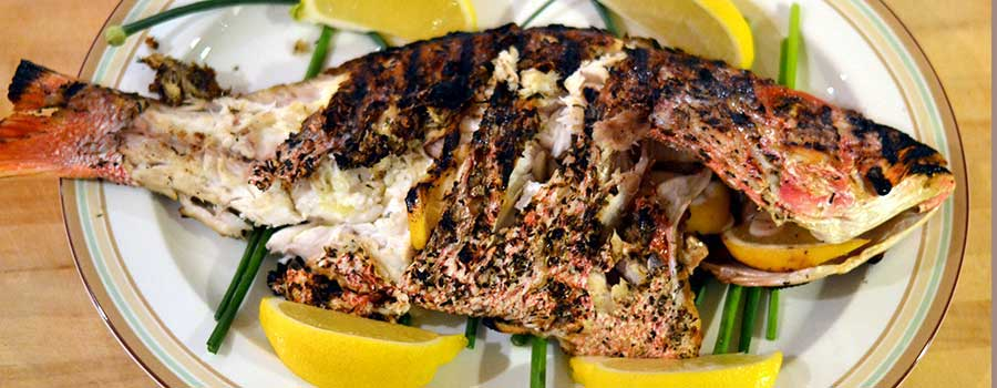 GRILLED WHOLE RED SNAPPER WITH LEMON, GARLIC, AND HERBS